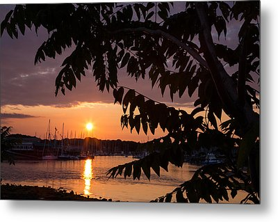 As It Sets Over The Harbor Metal Print