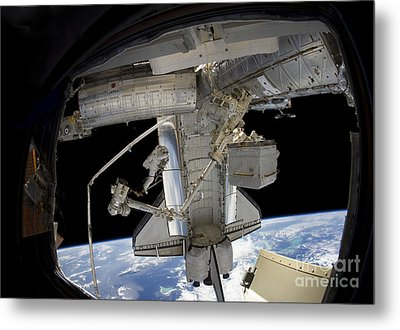 Astronaut Participates In A Spacewalk Metal Print by Stocktrek Images