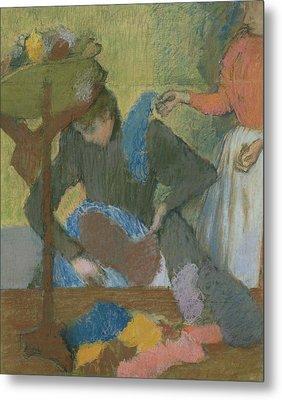 At The Hat Maker Metal Print by Edgar Degas