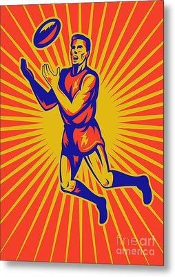 Aussie Rules Player Jumping Ball Metal Print by Aloysius Patrimonio