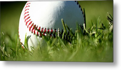 Baseball In Grass Metal Print by Chris Brannen