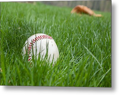 Baseball In Grass With Glove Behind Metal Print by Erin Cadigan