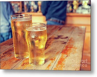 Metal Print featuring the photograph Beers In A Pub by Patricia Hofmeester