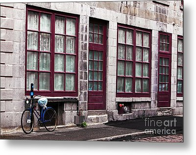 Bicycle In Old Montreal Metal Print by John Rizzuto