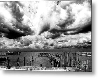 Big Clouds Little Dock Metal Print by John Rizzuto
