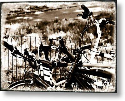 Bike Against The Fence Metal Print by Madeline Ellis