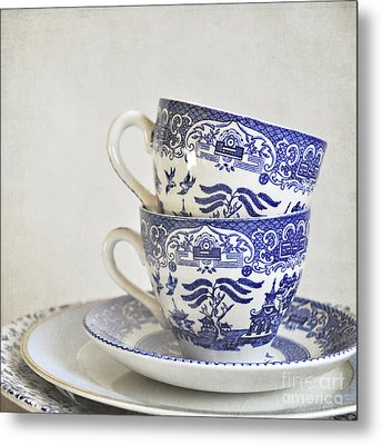 Blue And White Stacked China. Metal Print by Lyn Randle