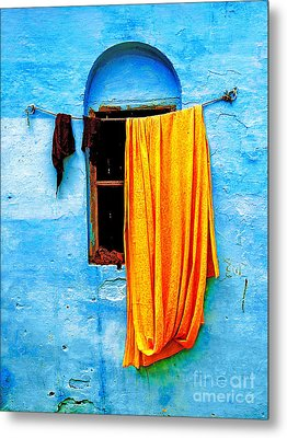 Blue Wall With Orange Sari Metal Print