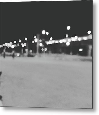 Blurred Lamp Poles On Street At Night  Metal Print