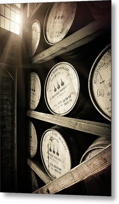 Bourbon Barrels By Window Light Metal Print by Karen Varnas