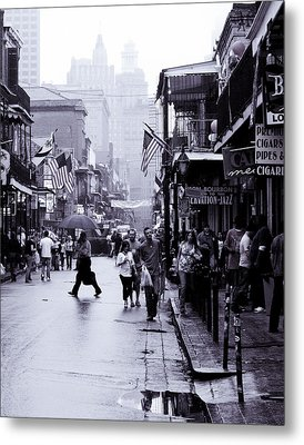 Bourbon Street In The Rain Metal Print by Ray Devlin