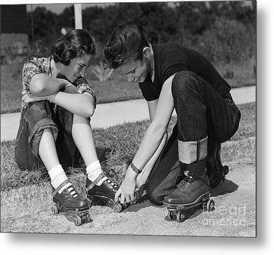 Boy Helping Girl With Roller Skates Metal Print