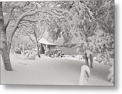 Cabin In Snow By The Sea Metal Print by Robert Ponzoni