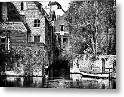 Canal Living In Bruges Metal Print by John Rizzuto