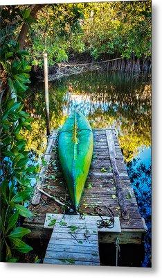 Canoe At The Dock Metal Print by Debra and Dave Vanderlaan