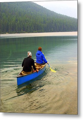 Canoeing Glacier Park Metal Print by Marty Koch