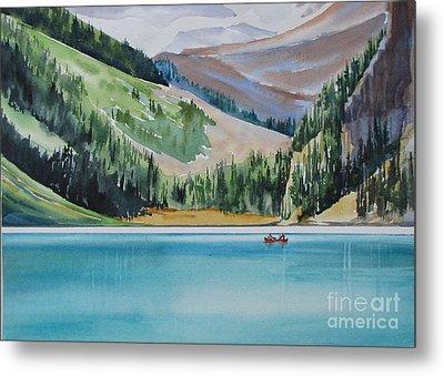 Canoeing-in-lake-louise Metal Print by Nancy Newman