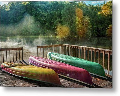 Canoes In The Sunshine Metal Print by Debra and Dave Vanderlaan