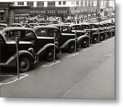 Cars Parked Diagonally Along Parking Metal Print by Everett