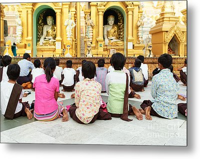 Metal Print featuring the photograph Children Pray At Shwedagon Pagoda by Dean Harte