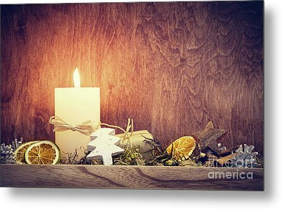 Chistmas Decoration With Candle Glowing On Wooden Wall Background Metal Print by Michal Bednarek