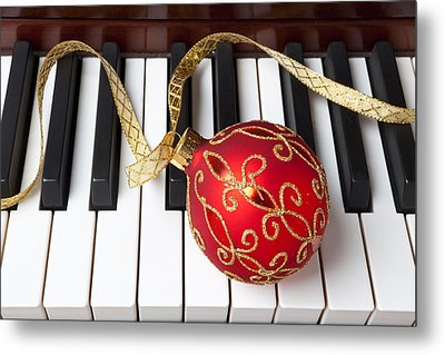 Christmas Ornament On Piano Keys Metal Print by Garry Gay