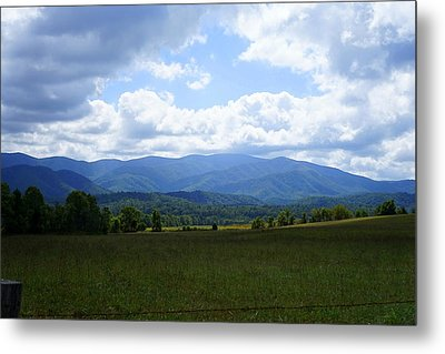 Clouds Over Cades Metal Print by Laurie Perry