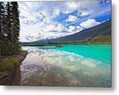 Clouds Reflected In A Tranquil Lake Metal Print by George Oze