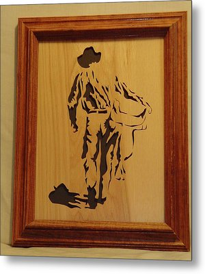 Cowboy And Saddle Metal Print by Russell Ellingsworth
