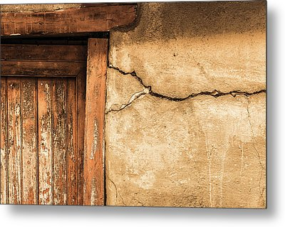 Cracked Lime Stone Wall And Detail Of An Old Wooden Door Metal Print by Semmick Photo