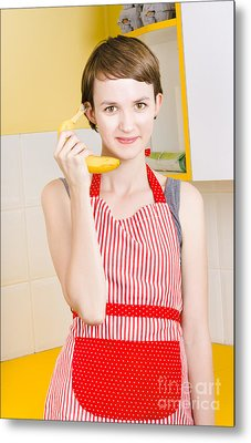 Cute Girl Talking On Fruit Phone In Kitchen Metal Print by Jorgo Photography - Wall Art Gallery