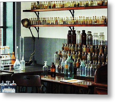 Desk With Bottles Of Chemicals Metal Print by Susan Savad