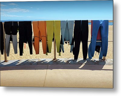 Drying Wet Suits Metal Print by Carlos Caetano