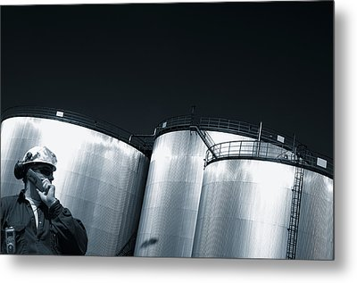 Engineer And Oil Towers At Sunset Metal Print by Christian Lagereek