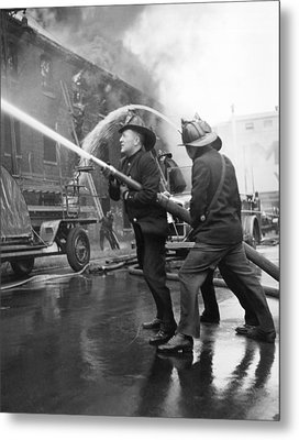 Firemen With Hose Metal Print by Underwood Archives