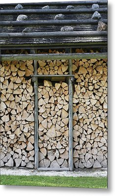 Firewood Stack Metal Print by Frank Tschakert