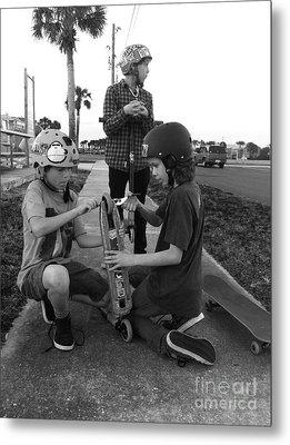 Fixing A Skooter Metal Print by WaLdEmAr BoRrErO
