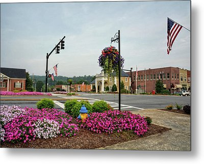 Flags And Flowers In Murphy North Carolina Metal Print by Greg Mimbs