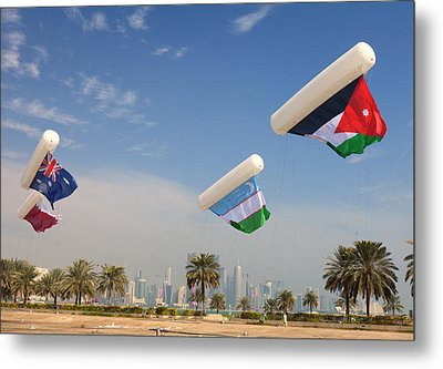 Flags Over Doha Metal Print by Paul Cowan