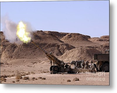 Flame And Smoke Emerge From The Muzzle Metal Print by Stocktrek Images