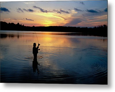 Fly-fisherman Silhouetted By Sunrise Metal Print by Panoramic Images