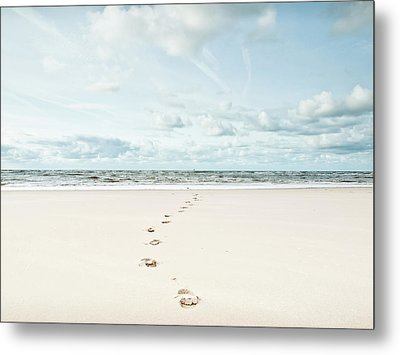 Footprints Leading Into Sea Metal Print by Dune Prints by Peter Holloway