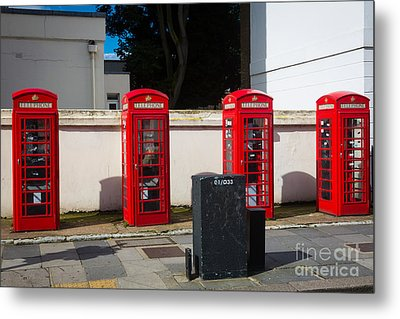 Four Phone Booths In London Metal Print by Inge Johnsson