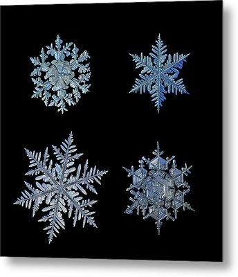 Four Snowflakes On Black Background Metal Print