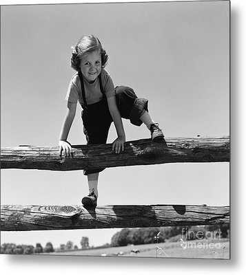 Girl Climbing Over Wooden Fence Metal Print
