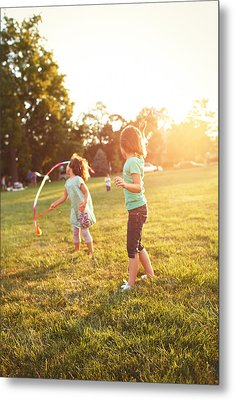 Girls Playing Together On Evening Lawn Metal Print by Gillham Studios