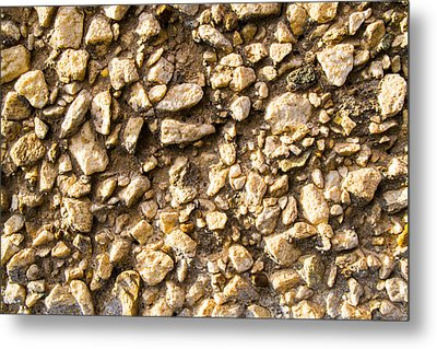 Gravel Stones On A Wall Metal Print by John Williams