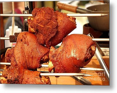 Grilled Pork Knuckles On A Spit Metal Print by Yali Shi
