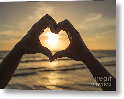 Hands Forming Heart Around Sunset Metal Print by Edward Fielding