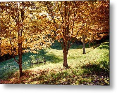 Hay Rake Under Fall Foliage Metal Print by Jeff Folger
